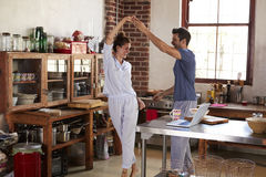 Happy Hispanic couple dancing in kitchen in the morning Royalty Free Stock Photography