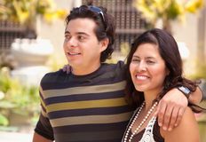 Happy Hispanic Couple At The Park. Attractive Hispanic Couple Enjoying Themselves At The Park Stock Photo