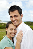 Happy hispanic couple smiling Stock Photography