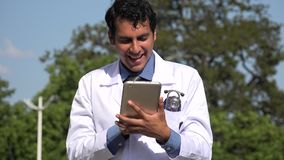 Happy hispanic doctor using tablet. A handsome adult hispanic man stock video
