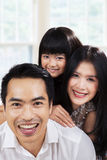Happy hispanic family at home. Portrait of hispanic family smiling on camera at home Stock Photo