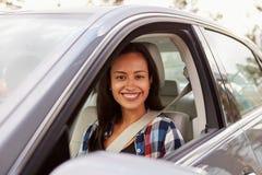 Happy Hispanic female driver in a car Stock Image