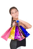 Happy hispanic female shopper holding shopping Stock Photo