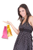 Happy hispanic female shopper holding shopping Royalty Free Stock Photo