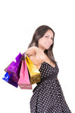 Happy hispanic female shopper holding shopping Stock Image
