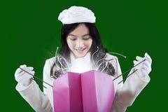 Happy hispanic girl opening shopping bag Royalty Free Stock Image