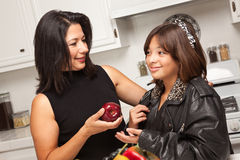 Happy Hispanic Girl Ready for School with Mom Royalty Free Stock Photography