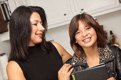 Happy Hispanic Girl Ready for School with Mom Stock Photos