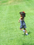 Happy hispanic girl running in park Stock Images