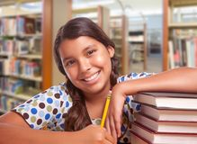 Free Happy Hispanic Girl Student With Pencil And Books Studying In Library Royalty Free Stock Images - 123459079