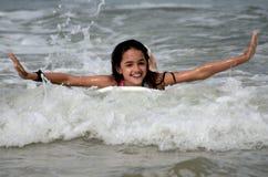 Happy Hispanic Girl Surfing Stock Photo