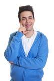 Happy hispanic guy in a blue hoody Stock Photos
