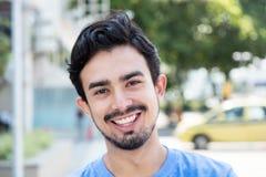 Happy hispanic guy in the city Stock Photo