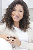 Happy Hispanic Latina Woman Drinking Red Wine Stock Photography