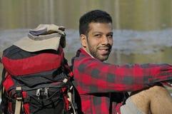 Happy Hispanic Man with Backpack Royalty Free Stock Photo