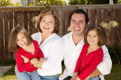 Happy Hispanic mother and father with their daughters. Stock Images