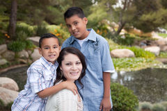 Happy Hispanic Mother and Sons. In the Park Royalty Free Stock Photos