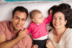 Happy Hispanic parents and their baby stock photos