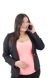 Happy hispanic pregnant woman talks at cell phone Royalty Free Stock Images