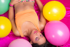 Happy hispanic woman with balloons Stock Photo