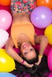 Happy hispanic woman with balloons Royalty Free Stock Photos