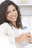 Happy Hispanic Woman Drinking Bottle of Water Royalty Free Stock Images