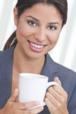 Happy Hispanic Woman Drinking Tea or Coffee Stock Photo
