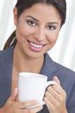 Happy Hispanic Woman Drinking Tea or Coffee Stock Photo