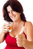 Happy  hispanic woman drinking whisky Royalty Free Stock Photography
