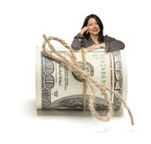 Happy Hispanic Woman Leaning on a Roll Of Hundred  Stock Image