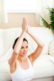 Happy hispanic woman meditating in her living-room Royalty Free Stock Photos