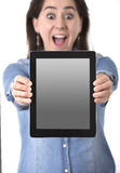 Happy Hispanic woman showing digital tablet pad holding on her hands screen as copy space Royalty Free Stock Photos