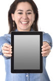 Happy Hispanic woman showing digital tablet pad holding on her hands screen as copy space Stock Photo
