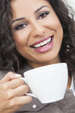 Happy Hispanic Woman Smiling Drinking From a Cup Stock Photo