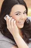 Happy Hispanic Woman Talking On Her Cell Phone Stock Photography