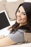 Happy Hispanic Woman Using Laptop Computer Stock Photo