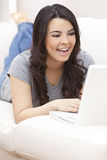 Happy Hispanic Woman Using Laptop Computer Royalty Free Stock Photo