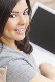 Happy Hispanic Woman Using Laptop Computer stock images