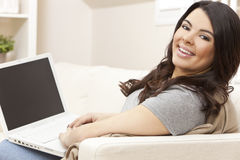 Happy Hispanic Woman Using Laptop Computer at Home Stock Photography