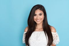 Happy Hispanic Woman. Happy young hispanic woman who is smiling royalty free stock photo