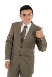 Happy hispanic young business man with thumbs up. Gesture. This image has attached release stock photo