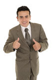 Happy hispanic young business man with thumbs up Royalty Free Stock Images