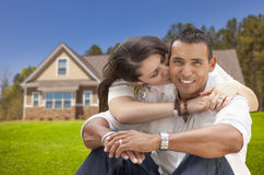 Happy Hispanic Young Couple in Front of Their New Home Royalty Free Stock Images