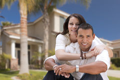 Happy Hispanic Young Couple in Front of Their New Home Royalty Free Stock Image