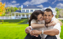 Happy Hispanic Young Couple in Front of Their New Home Royalty Free Stock Photography