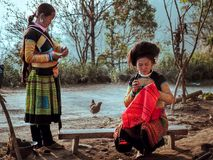 Happy Hmong Woman is embroidering in sunset, Ta Xua, Son La, Vietnam stock image