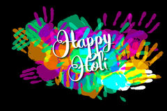 Happy holi on a background of hand prints Royalty Free Stock Image