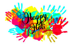 Happy holi on a background of hand prints Stock Photography