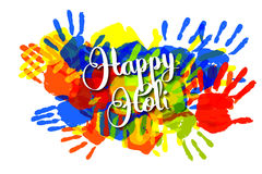 Happy holi on a background of hand prints Royalty Free Stock Images