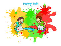 Happy Holi festival celebration with little kids. Cute little kids throwing colors on each other for Indian festival, Happy Holi celebration Royalty Free Stock Photo